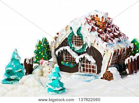 gingerbread house and candy for the holiday merry christmas on white background