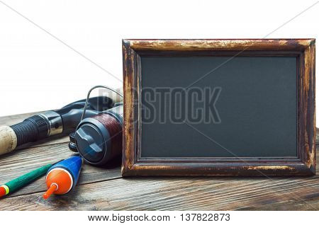 fishing gear and blackboard isolated on white background
