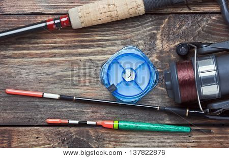fishing tackle on a wooden table. Focus on the float.