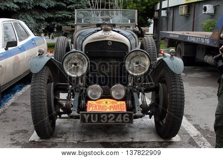 PERM RUSSIA - JUNE 29 2016: Rally of retro-cars Peking-Paris 2016 June 29 2016 in Perm Russia. Bentley Le Mans is near the hotel after the next stage.