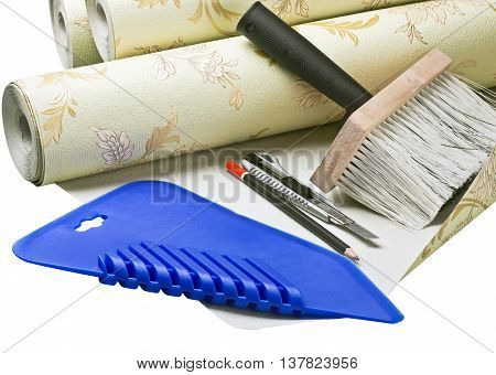 paper wallpaper and tools for sticking on a white background