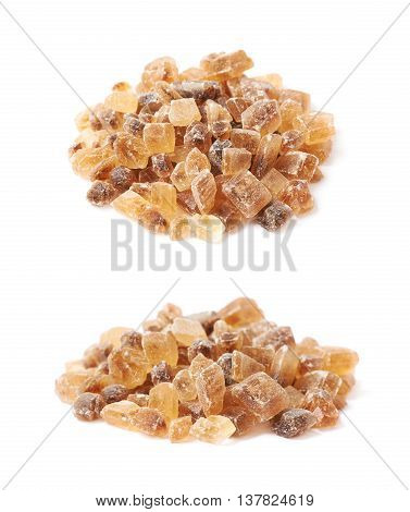Pile of brown rock sugar crystals isolated over the white background, set of two different foreshortenings