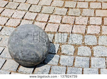 granite stone ball rests on the rocks