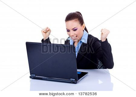 Woman In Office Jubilates At Desk