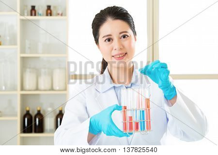 Asian Female Scientist Researcher Observing Indikator Color Shift