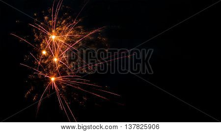 Colorful fireworks abstract pattern with glowing lines. Red orange flash on black scene background.