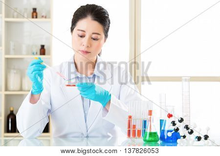 Young Asian Scientist Doing Laboratory Test For Dna