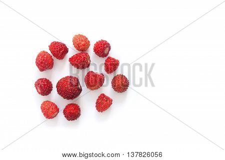 Wild strawberries on white background. Red ripe berries Fragaria. closeup