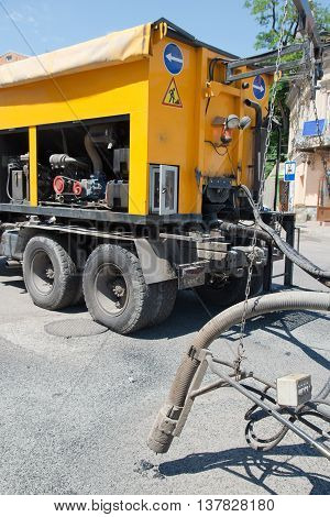 machine during road construction and repairing works