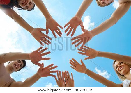 Circle of people? hands on blue sky background