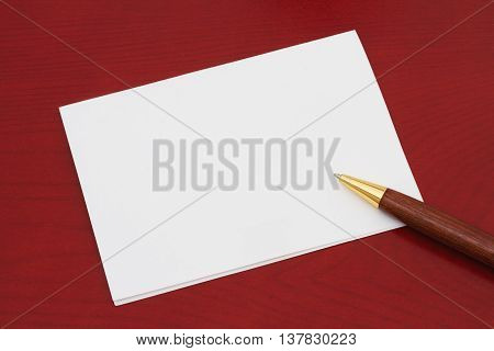 Blank Greeting Card White Greeting card that is blank for your message on a red wood background