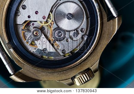Macro view wristwatch, clock mechanism with gears. Shallow depth of field closeup