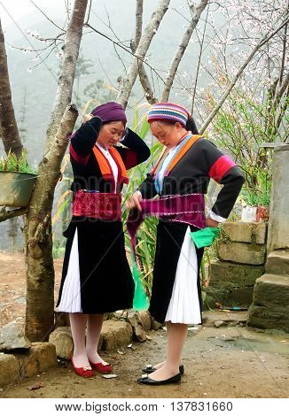 HA GIANG, VIETNAM, February 2, 2016 two ethnic Hmong teenager, highland Ha Giang, Vietnam, traditional costume beauty