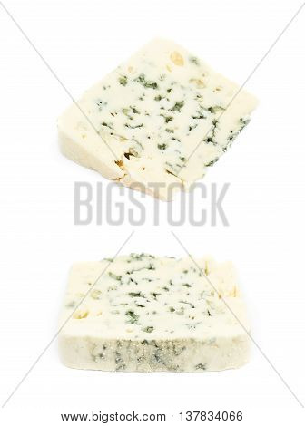 Slice of a blue roquefort cheese isolated over the white background, set of two different foreshortenings