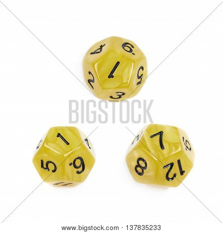 Yellow roleplaying polyhedral dodecahedron gaming plastic dice isolated over the white background, set of three different foreshortenings