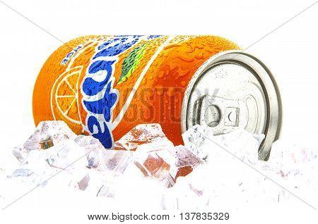 SWINDON UK - JANUARY 26 2014: Fanta Icy Orange on a bed of ice over white background