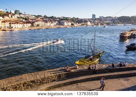 PORTO, PORTUGAL - JUL 9, 2016: Tourist boats on the Douro river at Ribeira, historical center of Porto. City of Porto won the European Best Destination 2012 and 2014 awards.