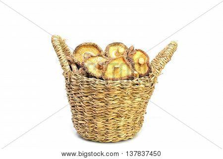 Dried shiitake mushroom in basket on white background