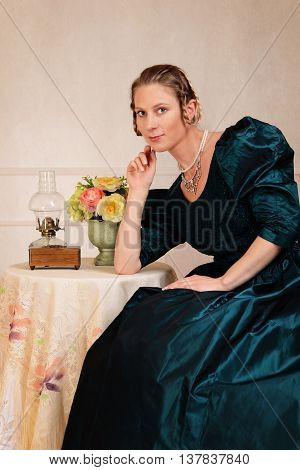 portrait of smiling Victorian woman sitting at table