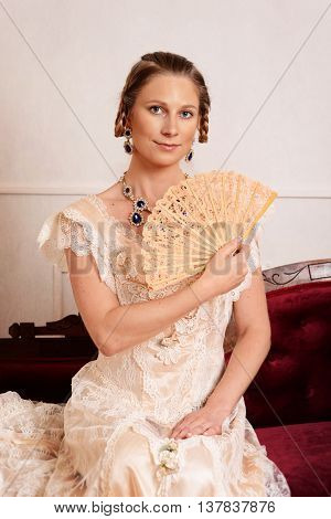 portrait of Victorian woman using lace fan