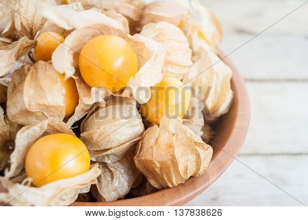 Cape gooseberry (Physalis) in wooden bowls on table