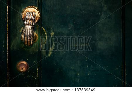 Vintage Door Handle with Dark Dusty Scratchy Texture/ black wall background