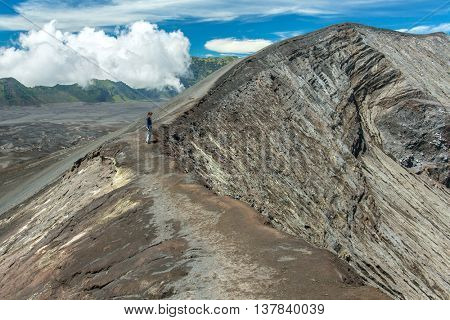 Tourist on the crater of Bromo volcano, Java island, Indonesia