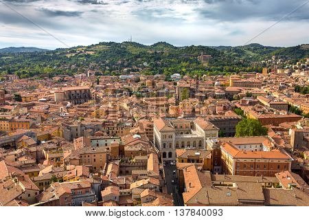 Aerial view of red tiled rooftops and ancient Due Torri towers in historical center of Bologna, Italy