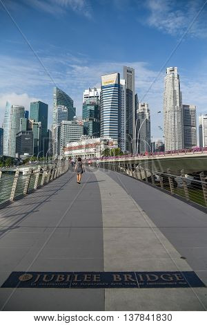 SINGAPORE - MAY 6 2016 : Cityscape of Singapore business district skyline and pedestrian walkway on Jubilee bridge.