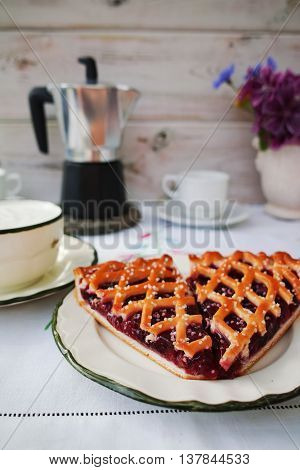 Summer breakfast in a terrace - coffee natural yogurt fresh cherry pie and flowers