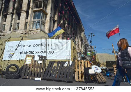 KIEV, UKRAINE - FEB 10, 2014: Burned downtown of Kiev with poster - Poland support free Ukraine ( Ukrainian). Riot in Kiev. February 10, 2014 Kiev, Ukraine