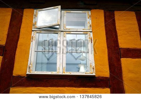 window of a timber framed building with mediterranean decoration