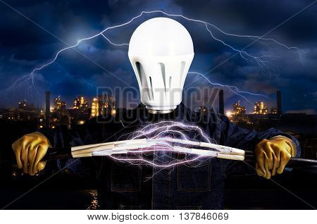 Electrician with a light bulb instead of a head on the background of industrial landscape and sky with lightning