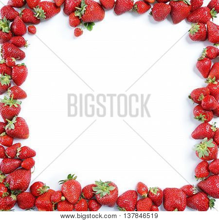 Fram from ripe strawberry on white background. Copy space top view high resolution product.