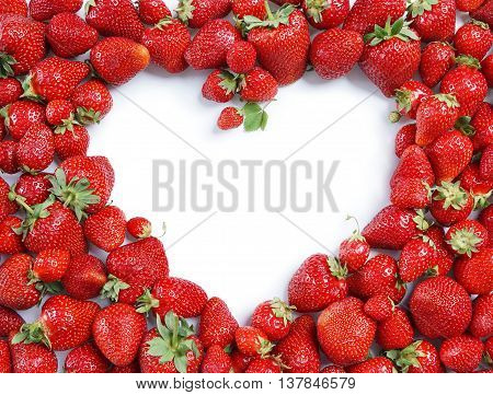 Heart made from deluxe strawberry on white background. Copy space. Top view high resolution product.