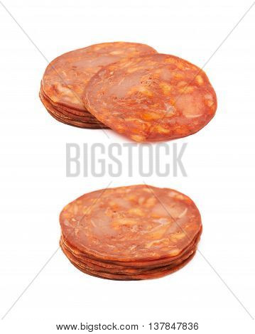 Pile of Italian sausage salame ventricina isolated over the white background, set of two different foreshortenings