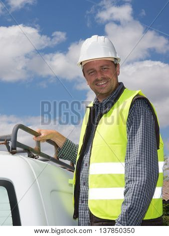 Happy Worker Wearing Safety Equipment, In Front Of Truck.