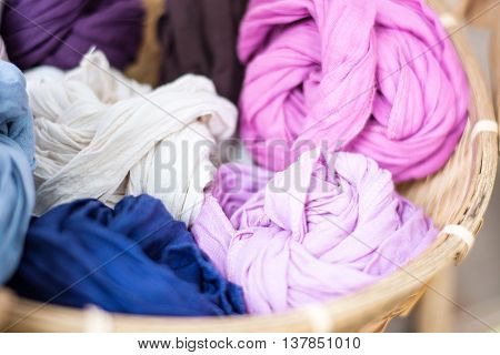 close-up of colorful dyeing in wooden basket