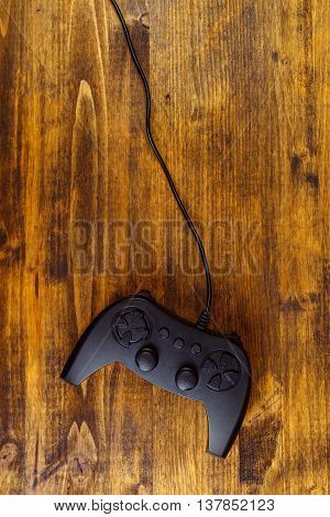 Game pad controller on wooden desk flat lay top view gaming and entertainment concept with copy space
