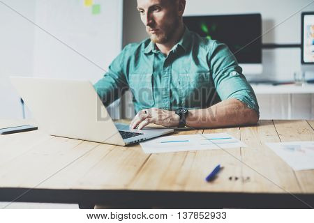 Online Market Economist Working Wood Table Laptop Modern Interior Design Loft Place.Businessman Work Coworking Studio.Men Use contemporary Notebook typing keyboard.Blurred Background Business Startup