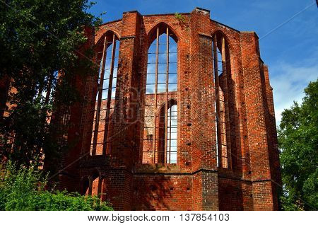 ruin of an old monastery with blue sky in stralsund germany