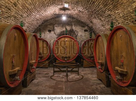 Wine barrels in a Montepulciano cellar Tuscany