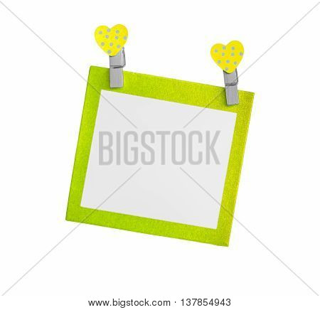heart and blank paper card on white background, Selective green color.