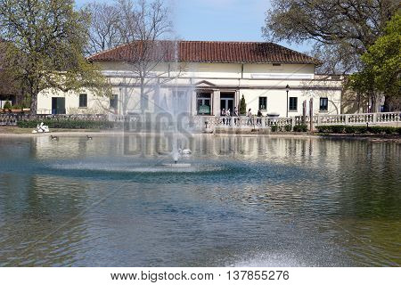 BROOKFIELD, ILLINOIS / UNITED STATES - APRIL 23, 2016: A fountain aerates the water in Brookfield Zoo's historic Formal Pool.