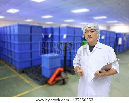 A man in white great coat uniform and Plastic container box of background for Concept design Quality Inspection Business.