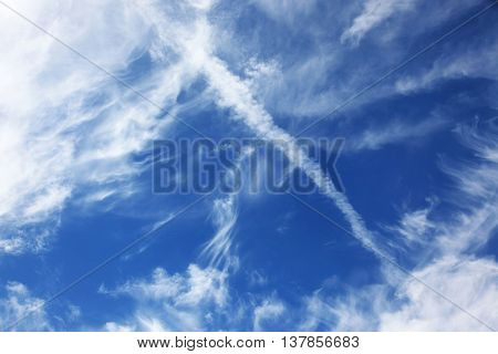 blue sky background with white clouds of different shapes