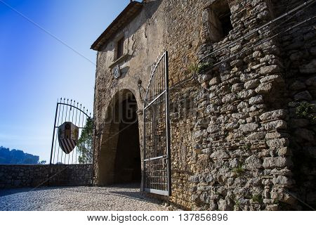 Iron gate at the entrance of an ancient village