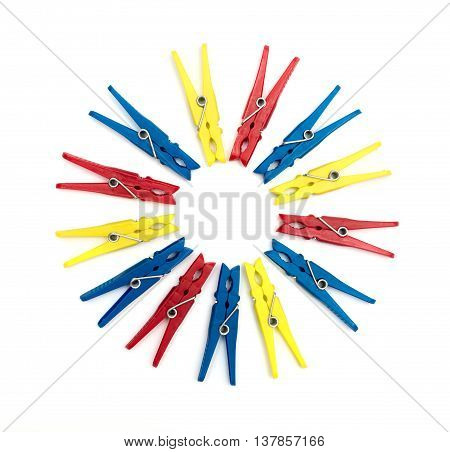 Multicoloured plastic clothes pegs on a white background