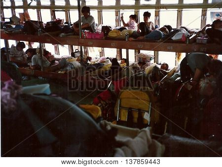 GUANGZHOU / CHINA - CIRCA 1987: Passengers sleep in numbered berths on a river boat between Guangzhou and Wuzhou.