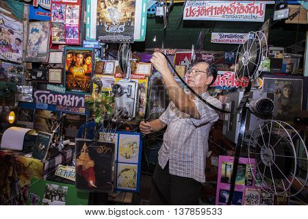 BANGKOK THAILAND - June 9 2016: Projectionist taping the end of the film at an temporary screening in Lampang Thailand